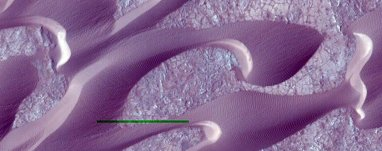 wind-shaped-features-on-mars--the-green-bar-is-leftover-from-processing-the-image