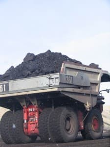 A haul truck carries a load of Powder River Basin coal out of the pit. (Dustin Bleizeffer/WyoFile — click to enlarge)
