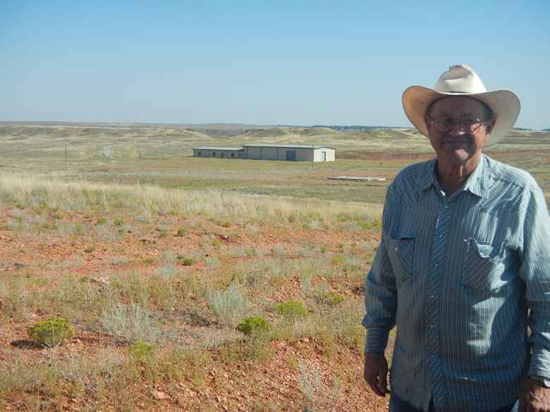 Campbell County rancher Dan Tracy lives near the proposed Two Elk power generation site. After two decades in the works, only a concrete pad, a tin building and some dirt work exist. (Rone Tempest/WyoFile)