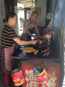 Food workers prepare for the lunch hour in Taiyuan, in China's coal-producing region. (Dustin Bleizeffer/WyoFile)