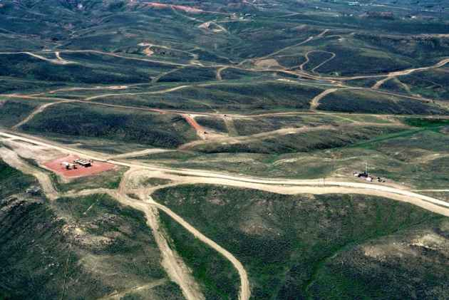CBM activity in the Powder River Basin is depicted by new road and pipeline installations in this 2002 file photo. If the number of orphaned CBM wells continue to rise state officials say a mill levy tax increase might be necessary to permanently close the wells. (Photo courtesy of Powder River Basin Resource Council )