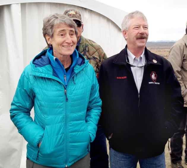 Secretary of the Interior Sally Jewell and Wyoming Sage Grouse Implementation Team chairman Bob Budd watch migrating antelope near Trappers' Point in Sublette County in October, 2014. Budd has the difficult task of accommodating greater sage grouse and energy development in a state plan. Jewell will ultimately determine whether those efforts are sufficient to stave off federal endangered-species protection of the bird. (Angus M. Thuermer Jr./WyoFile)