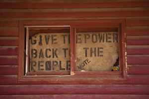 A sign posted in the window of the Chicken Coop in Lame Deer, Montana shows that Northern Cheyenne tribal members are looking for a change