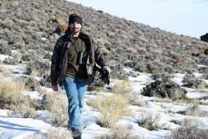 Mark Dantzker walks across the sagebrush while working on a documentary about sage grouse. (Courtesy Gerrit Vyn)