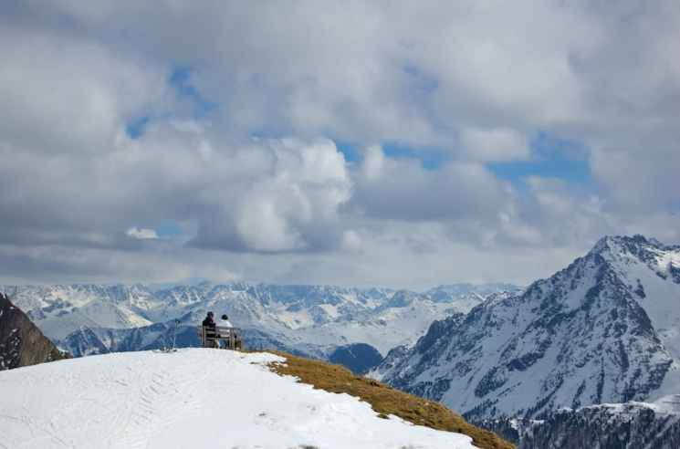 Two skiers enjoy the view from the top of Ischgl Ski Resort in Tyrol, Austria. (Kendall Brunette)