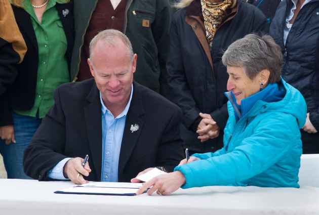 Gov. Matt Mead and Secretary of the Interior Sally Jewell signed sage grouse conservation agreements with ranchers in 2014, but it is uncertain whether another deal to preserve state trust school sections in Grand Teton National Park can be reached by a legislative deadline. Wyoming must manage the school land for the benefit of public education, even if that means selling the environmentally sensiitive land for development. (Angus M. Thuermer Jr/WyoFile)