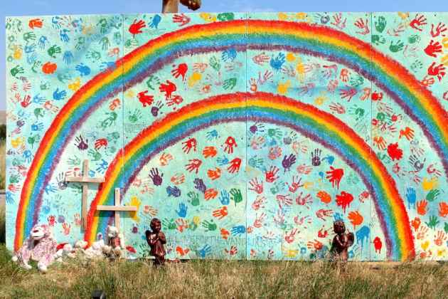 Community members painted this memorial for Noah and Zephan van Dijk on Lyons Valley Road south of Lander. The double rainbow is a symbol of remembrance for the family's sons, partly because of the biblical story of the rainbow that appeared after the great flood. (Gregory Nickerson/WyoFile)