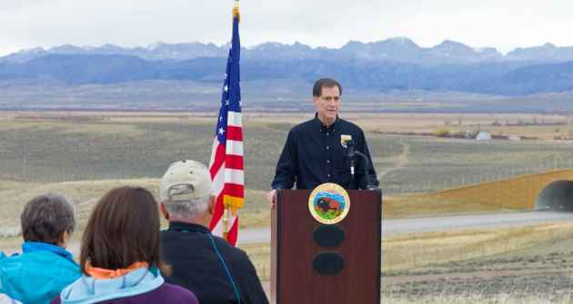 U.S. Fish and Wildlife Service Director Dan Ashe addresses a gathering at Trappers Point while celebrating greater sage grouse conservation achievements in 2014. Ashe's agency is responsible for deciding whether the grouse still merits protection under the Endangered Species Act. (Angus M. Thuermer Jr./WyoFile)