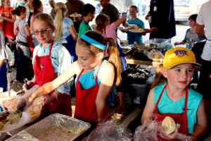 Members of the Future Farmers of America club serve food at the Little Snake River Valley community picnic on Sept. 13, 2015. (Gregory Nickerson/WyoFile)