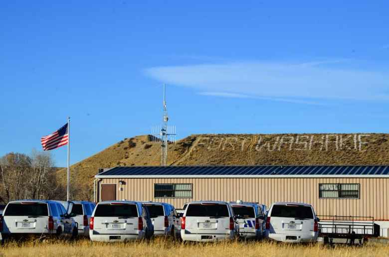 Health care, education, housing, natural resource development, wildlife management, law enforcement — the federal government continues to play a role in nearly every aspect of public life on the Wind River Indian Reservation. The fleet of vehicles and array of communications antennae at the Law Enforcement Services Center in Fort Washakie serve as a prominent and often uncomfortable reminder of the government's role to anyone passing through town. (Matthew Copeland/WyoFile)