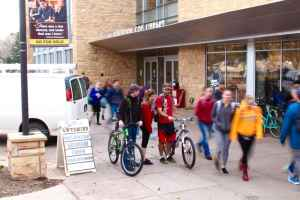 University of Wyoming students in front of Coe Library. As the state faces a $159 million projected deficit for 2016, the University of Wyoming has set up a process for granting exemptions to the hiring freeze. (Gregory Nickerson/WyoFile)