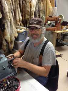 """Merlin Heinze sews a buffalo hide into a coat for the movie """"The Hateful Eight."""" (courtesy)"""