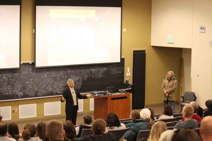 """UW presidential candidate Jeremy Haefner speaks at a Dec. 14 forum while Staff Senate president Arron Sullivent '92 looks on. """"A lot of staff are alums, so that's why we have a vested interest,"""" Sullivent said. (WyoFile/Gregory Nickerson)"""