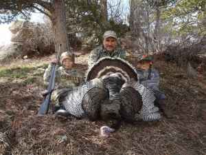 Jeff Muratore poses with his grandsons Shane Lovelance and Carter Muratore with a turkey he nabbed hunting in the Deer Creek Range of the Laramie Mountains. (Photo courtesy of Jeff Muratore)