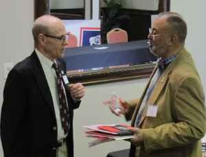 GOP candidate for U.S. House of Representatives Charlie Tyrrel visits with a constituent at the GOP's state convention Friday in Casper. (Dustin Bleizeffer/WyoFile)