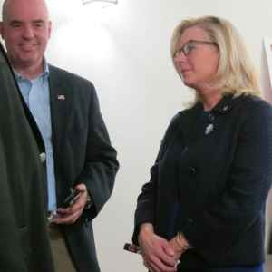Wyoming GOP U.S. House candidate Liz Cheney and her husband Philip Perry at the Wyoming GOP state convention in Casper. Columnist Kerry Drake says she's managed to make herself appear to be the presumptive leader in the race. (Dustin Bleizeffer/WyoFile)