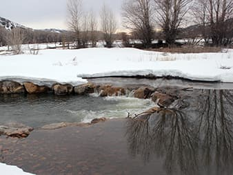 """The O'Tooles installed """"rock drop"""" structures to keep Battle Creek deep, narrow and oxygenated – favored habitat for trout. Photo by Phil Taylor."""