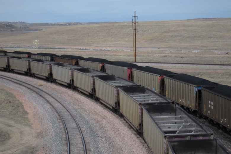 One loaded coal train rolls out of Arch Coal's Black Thunder mine as an empty train is in queue. Arch, now under Chapter 11 Bankruptcy, promises to keep commitments to retirees. (Dustin Bleizeffer/WyoFile)