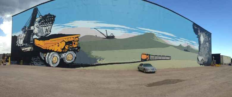 Wyoming's reliance on coal revenues is writ large in this mural at L&H Industrial in Gillette. It symbolizes the size, scope and influence coal mining has on the state and the resulting disruption a downturn in coal revenue has had. (Dustin Bleizeffer/WyoFile)