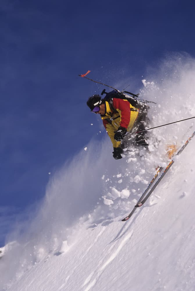 """Doug Coombs skis in Alaska. The skier, who died in 2006, is credited with opening Alaska's backcountry to guided heli-skiing. His life is the subject of a book """"Tracking the Wild Coomba."""" (Ace Kvale photo)"""
