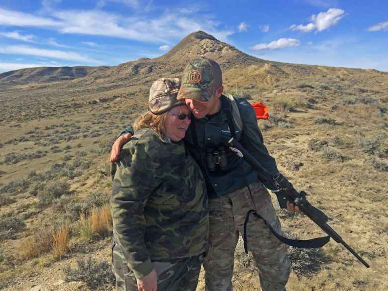 Kellen Little, a guide for the Wyoming Women's Antelope Hunt, congratulates an emotional Tonya Lewman after her successful kill of her first antelope Oct 7. Local ranchers like Little donate their property for the hunt and act as guides. While all of the hunters are women, almost all the guides are men due to a lack of femaile guides in the area. (Kelsey Dayton photo)