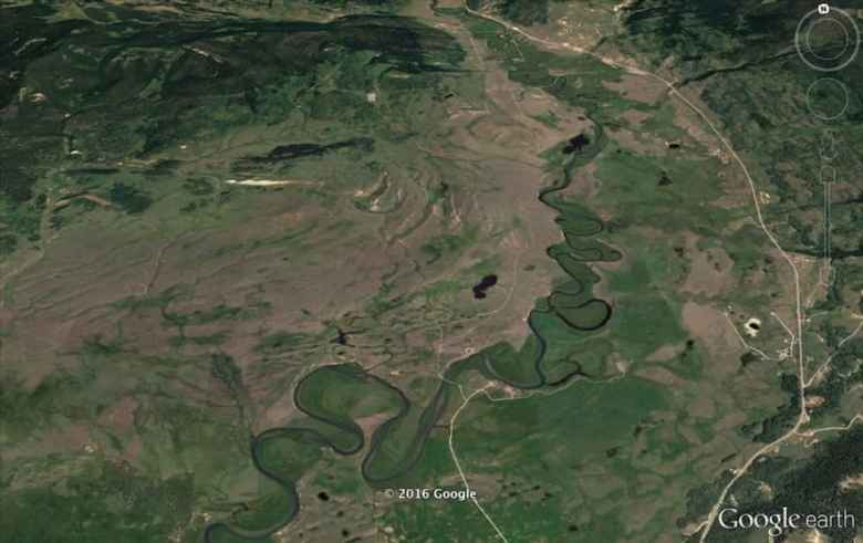 The Cline Ranch straddles the Green River in this Google Earth image looking north. The Path of the Pronghorn follows the open valley just west, or left, of the Green River. (Google Earth)