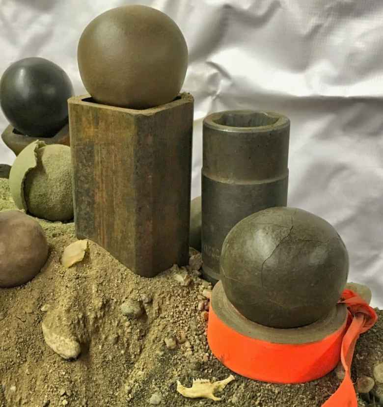 Five dorodango shaped from local soils. Each ball is approximately 3.5 inches in diameter.