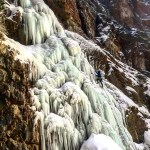 Wyoming Mountain Guides' ice climbing guide Zach Lentsch leads an early season ice climb at Five Springs Falls near Lovell, Wyoming.