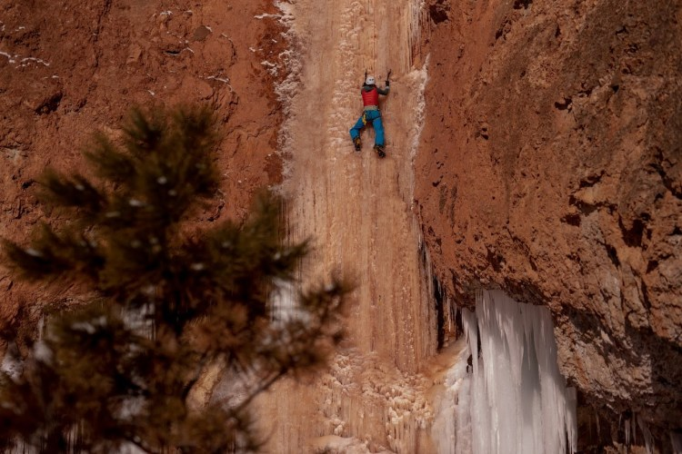 Discover the wonders of Wyoming in the winter with a custom ice climbing trip with Wyoming Mountain Guides. Photo of @wildkait climbing Ten Sleep Falls