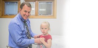 Chad E. Sundquist, PA-C with a young patient