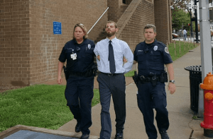 Caleb Cannon is led by Nashville police officers after his arrest on murder charges in the disappearance of Nikki Burgess.