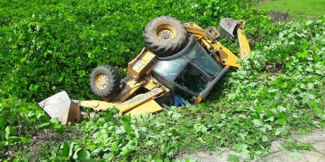 Oliver Springs employee injured when tractor overturns