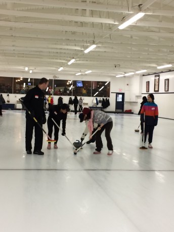 Somehow both of the instructors on our lane joined in on the sweeping of our final stone