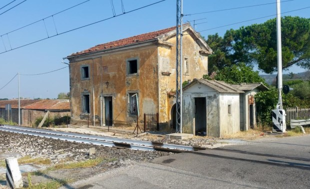 A, once lovely, railway side house.