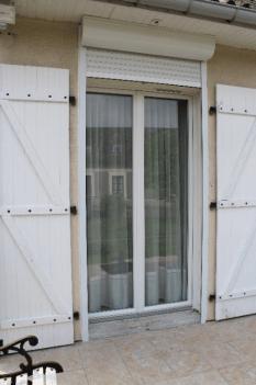 Porte fenêtre pvc + volet roulant alu