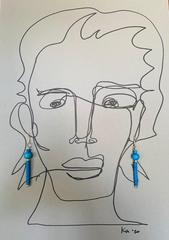 Turquoise hanger van kraaltjes
