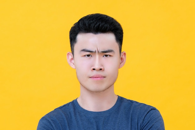 close up unhappy angry young asian man face 8087 4009
