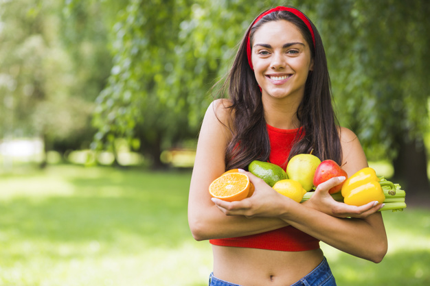 smiling young woman holding fresh vegetables fruits hands 23 2147855491