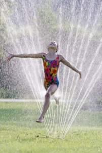 running barefoot through the sprinkler