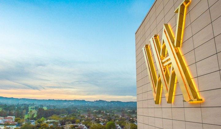 Waldorf Astoria logo on exterior wall of hotel