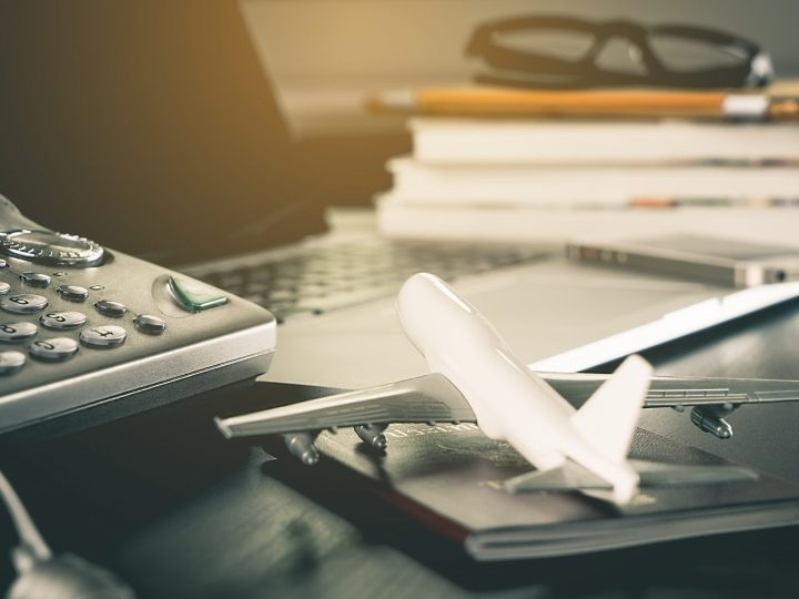 Model plane on desk with phone, laptop and smartphone in the background