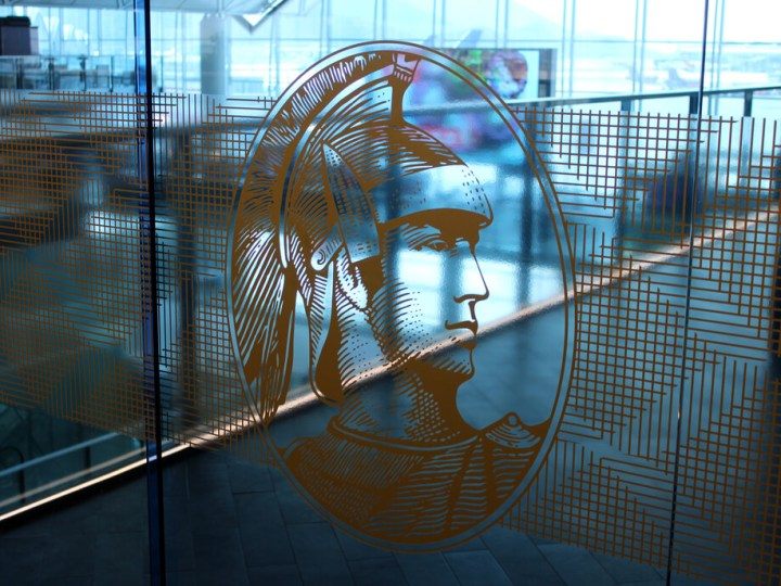 Amex Centurion logo on glass door