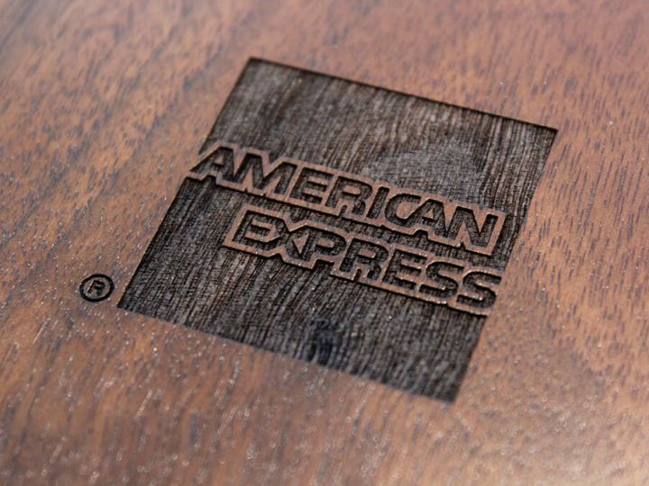 American Express logo on wooden surface