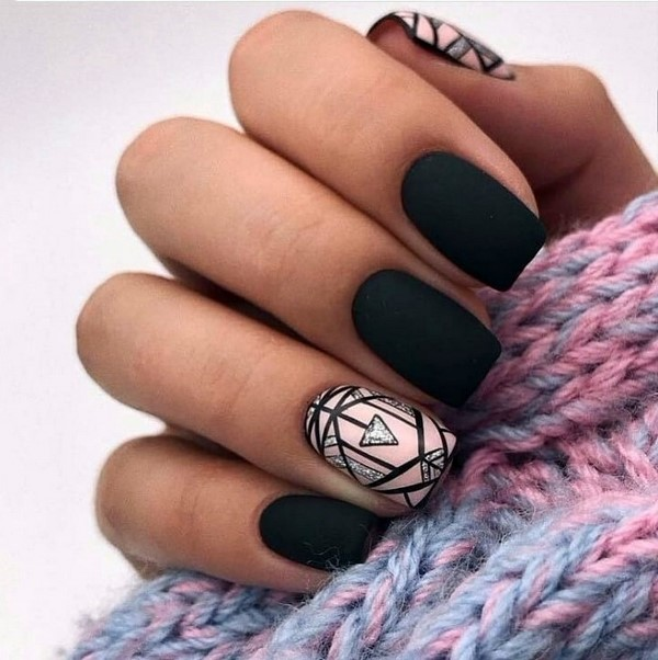 Black manicure with geometric shapes