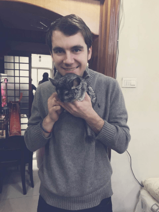 Another picture of me holding a chinchilla, love it (dragon cat in Chinese)