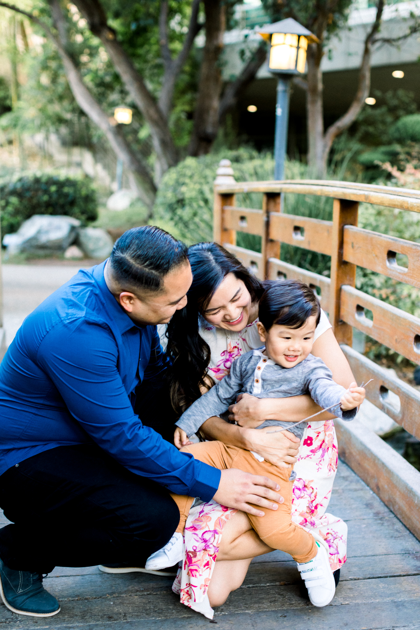 The Gomez family smiling and laughing during their family photography session in Pomona.