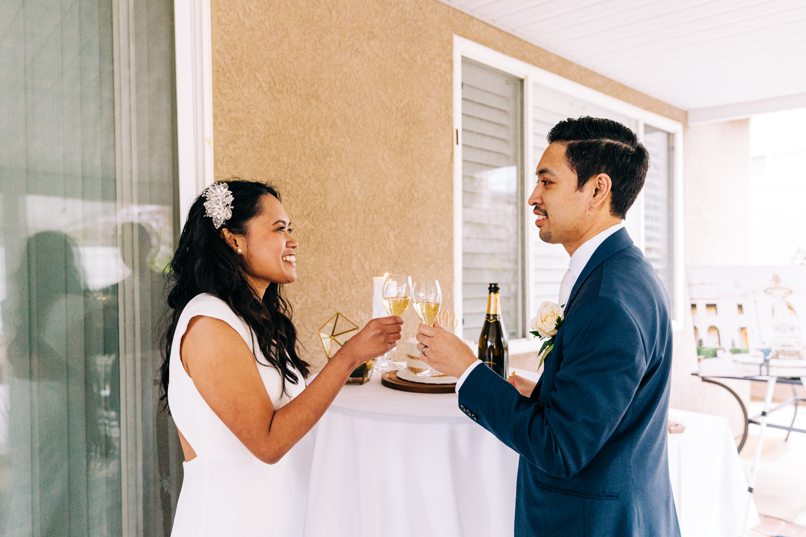 A bride and groom sharing a toast at their micro-wedding in Southern California.