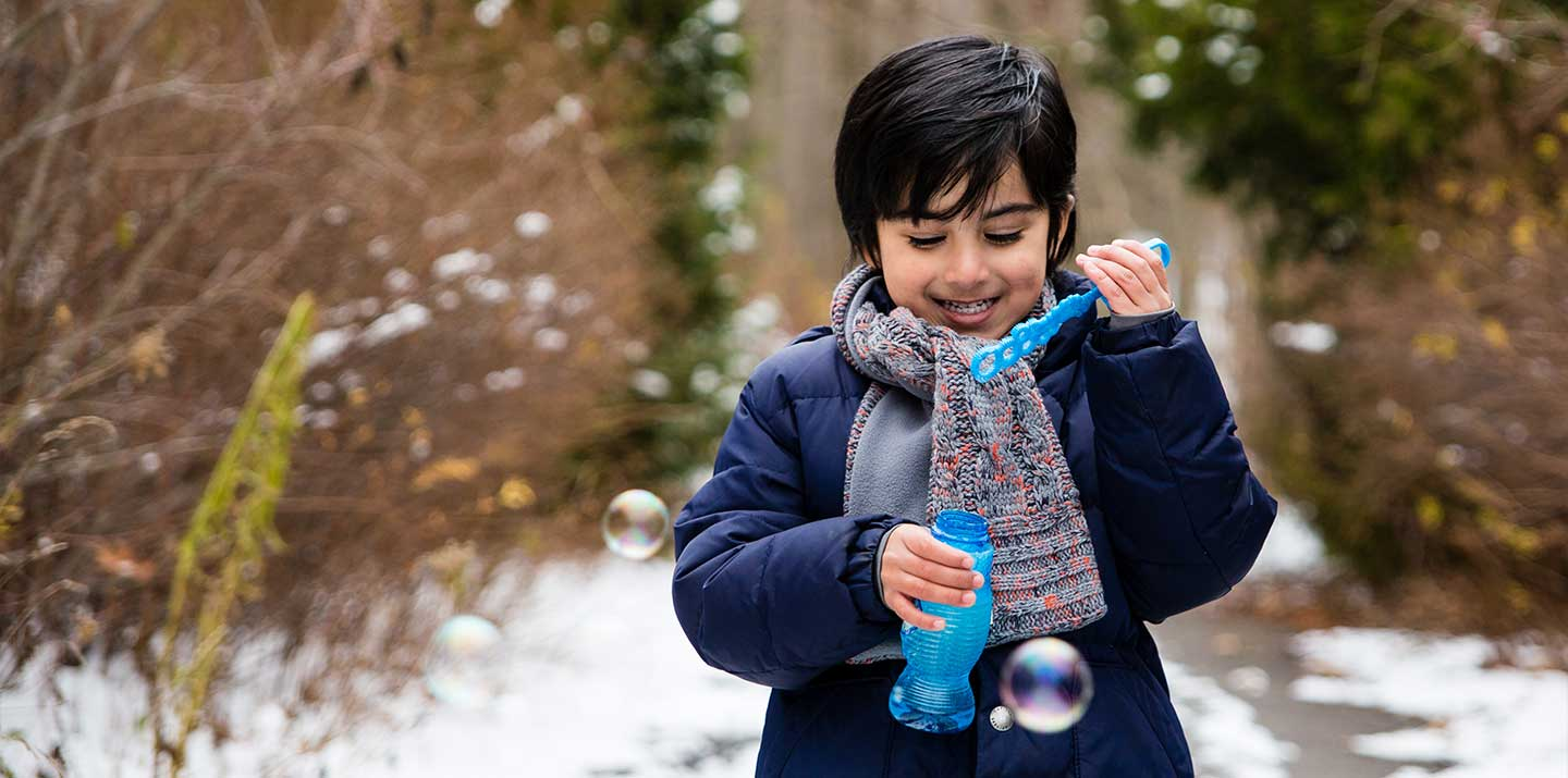 Photo of Child Blowing Bubbles in Waterloo, Ontario