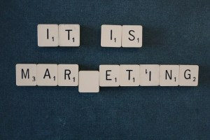"scrabble blocks arranged to spell ""it is marketing"""