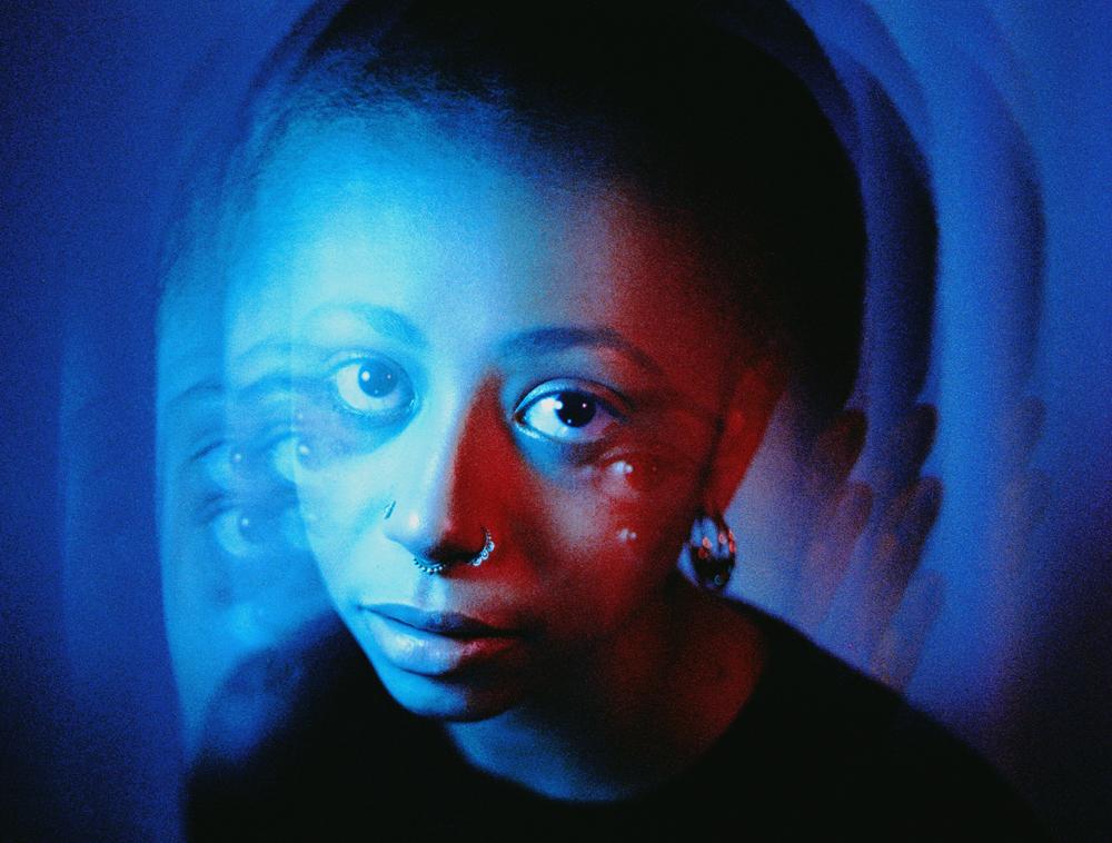 girl under blue neon light shot on cinestill 35mm